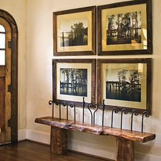 Reclaim & Restore | Mix found pieces to create unique furniture and accessories. This entryway combines a bench made from reclaimed wood beams and wrought iron fence materials with personal nature photographs framed in antique wood.