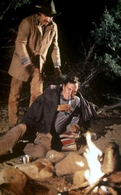 BITE THE BULLET (1975) - Gene Hackman tries to help a drunken Ben Johnson - Directed by Richard Brooks - Columbia Pictures - Movie Still.