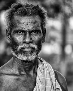 An old man with a fierce eyes that will protect his family.
