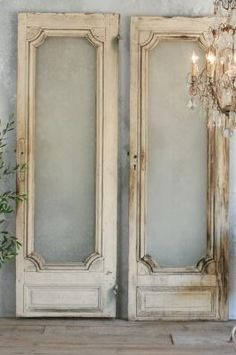 Projects with Old Doors--would make a beautiful headboard or pretty for any space. Just upholster the empty space with beautiful fabric.