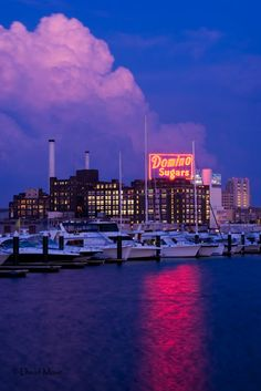 Baltimore's Inner Harbor at Twilight  God, I miss this place.  When I run through the city Domino sugar is to my left as I approach Federal Hill