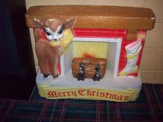 Vintage Christmas Blow Mold ~ Poloron Vacucel Fireplace with Deer & Stocking * Circa, 1950's  ---Pretty neat! I haven't seen one of these before.