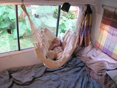 Baby in Baby Hammock above bed. I don't have a baby but the idea is pretty cute