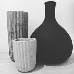 Concrete vase and matte black bottle
