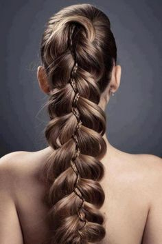 long braided ponytail. in love with this