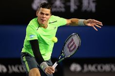 MELBOURNE, AUSTRALIA - JANUARY 28 2015 Milos Raonic of Canada plays a backhand volley in his quarter final match against Novak Djokovic of Serbia during day 10 of the 2015 Australian Open at Melbourne Park on January 28, 2015 in Melbourne, Australia. (Photo by Quinn Rooney/Getty Images)