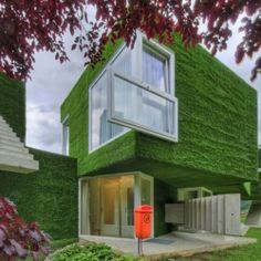 Synthetic Grass-Covered Volumes Adorned With Unusual Details.