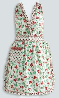 Cheri Cherry Apron, by Design India Imports. This lightweight cotton apron is in a sweet 50s style and a cheery cherry print. Ties in the back and at the neck, with a front pocket. 100% cotton. Machine washable, see label for care instructions.