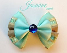 Up for your consideration is a Sulley mini hair bow. The bow measures 3 inches wide. This bow comes with an alligator clip attached. I also have a large version of this bow listed. Thanks for looking! *All items contain small parts that would be considered a choking hazard.