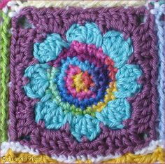 Natas Nest: Daisy Granny Blanket  ..love that she used varigated yarns for each of the centers