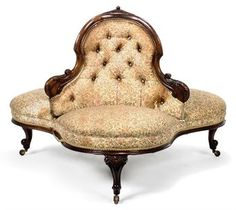 Mid Victorian carved mahogany conversation sofa.  Centered, three sided button-back over a trefoil shaped stuff-over seat on three squat cabriole legs and a central turned support. Christie's.   http://www.christies.com/lotfinder/furniture-lighting/a-mid-victorian-carved-mahogany-conversation-sofa-third-5376898-details.aspx
