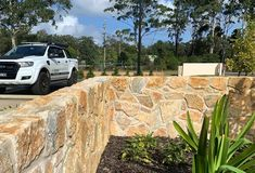 Laverton Irregular combine randomly a mixture of colours, from browns to reds and greys. Combined with a range of natural colours, textures and accessories.  sales@aussietecture.com.au NSV / ACT : 02 8378 0730 QLD: 07 3112 7562 Natural Stone Cladding, Natural Stone Wall, Natural Stones, Limestone Wall, Stone Supplier, Wall Cladding, Red And Grey, Granite, Gardening