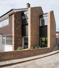 Architecture studio Selencky Parsons has extended a typical midcentury end-of-terrace house in southeast London by adding a pair of brick gables that diminish in size like Russian dolls