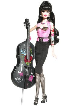 Edgy glam meets sleek style in one decadent doll courtesy of Hard Rock Cafe. Barbie rocks the rockabilly look in a pink bustier with golden and black trim, black pencil skirt, fishnets, and sky high Mary Janes. Cute tattoos decorate the doll arms, and adorable accessories include more than just the usual bling. A rockin' bass guitar to jam with the band accompanies this rock star! (for April lol)