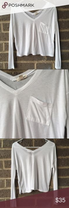 Urban Outfitters silence + noise white top Long sleeve v neck white top in perfect condition.  A must have basic top for your closet :)  ✅Offers through the offer button 🎀Ask for a custom bundle Urban Outfitters Tops Tees - Long Sleeve