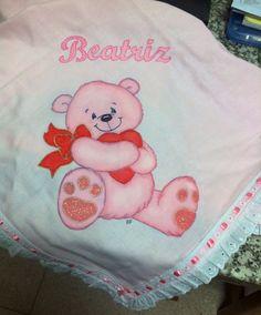 Fralda com ursinho cor de rosa