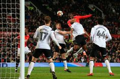 Manchester United's Belgian striker Romelu Lukaku leaps for a header but fails to score during the English FA Cup third round football match between...
