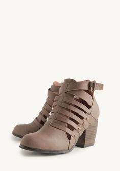 Crafted in taupe-colored faux leather, these stylish booties feature a woven design and gold-toned side buckles. Perfected with closed toes, stacked heels, and back zipper closures.                   $58.99 Mikayla Woven Booties at #Ruche @Mimi ♥♥