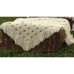 Chair alternative for weddings - bales of hay with mismatched crochet vintage throws - rustic country wedding