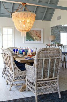 Coastal chic diing room with a gorgeous chandelier