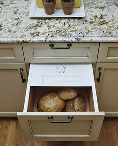 Bread Drawer... Then take a page from this homeowner, who wanted the butler's pantry to include an old-fashioned bread drawer with a ventilated lid, like one her grandmother had. The deep storage drawer keeps bread fresh and protected.