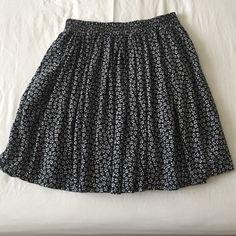 Brandy Melville Floral Mini Skirt Super comfortable brandy Melville skirt!! Beautiful addition to any outfit, navy and white floral pattern, 14.5 inches from waist to hem. Cotton, machine wash. Elastic waist, fits sizes xs-medium Brandy Melville Skirts Mini