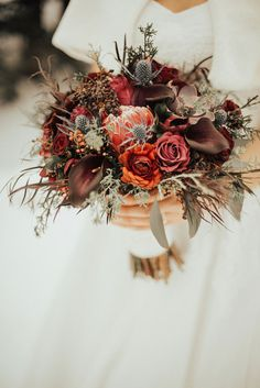 26 Wedding Bouquets for Winter Brides & Their Maids ~ in love with this unique dark hued wintery bouquet by Vintage Magnolia