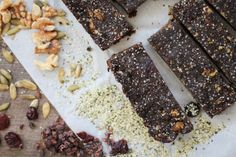 Protein Bars Dry: 1/2 c walnuts, ground 1/8 c chia seeds, ground 3/4 c hemp protein powder 1/4 c cocoa powder 1/4 c sliced almonds 1/4 c coconut flakes 2 generous pinches of salt 1/4 c mini chocolate chips Dash ground cinnamon Wet: 1 1/4 c dried cherries 2 TBLS coconut oil 1 heaping TBLS peanut butter 1 tsp vanilla 1/4 c water