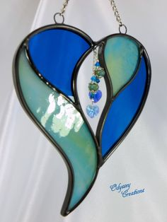 Two Hearts in One by the Sea  - Aqua and Blue Stained Glass Suncatcher with Swarovski Crystals. $21.95, via Etsy.