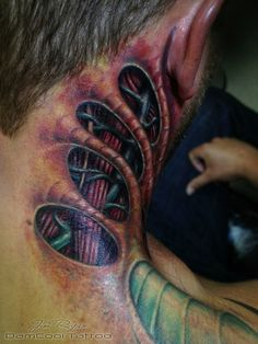 Bioneck ,biomechanical tattoo done by Jim Ryan @ DamCool Tattoo