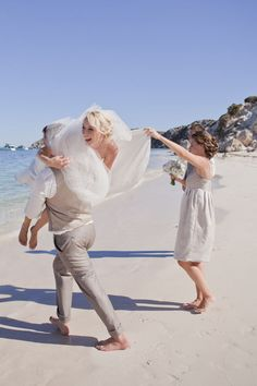Having a destination wedding on the beach gives your fiance the opportunity to do this to you. :)
