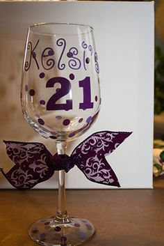 A wine glass I customized for someone special's 21st birthday.  I used my Silhouette Cameo to cut my vinyl.