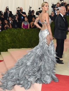 The 25-year-old pop star showed off the sheer paneling on the back of her gown