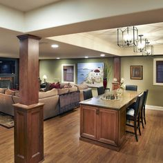 Nice way to cover up the support posts in the basement. Elmhurst Basement - Kristin Petro Interiors, Inc.