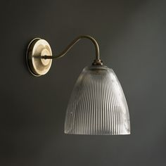 Wall lights Pooky's wall lights come in antique brass, nickel and antique silver. All-in-one, or mix up a fitting with one of Pooky's pendant shades