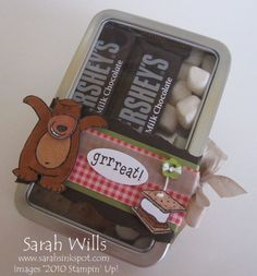 from sarah http://www.splitcoaststampers.com/gallery/photo/1977311?&si=treats  I have lots of these tins left good idea to use them up;)
