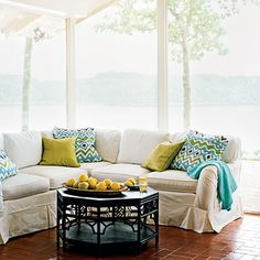 Create Effortless Style   For effortless style keep the color scheme simple. Here, blue and green accent pillows channel the outdoors.