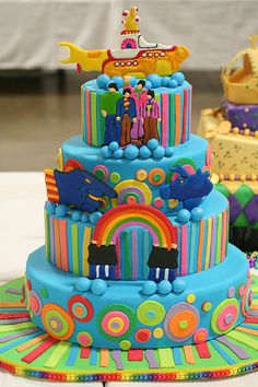 Colorful Yellow Submarine wedding cake. I would love to meet this happy couple. Wow !