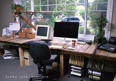 rustic desk with hints of modern. I like the rough look of the wood and the ease of the metal rolling drawer things