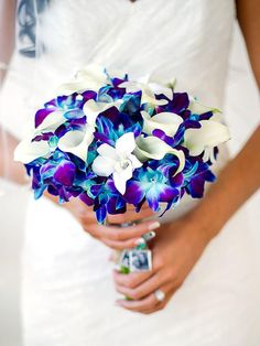 Make a striking statement with electric calla lilies and orchids for a wedding bouquet that boasts bright blues ranging from sapphire to indigo to aqua. #weddingflowers