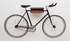 Wooden Bike Rack Walnut, Wooden Bike Shelf, Bike Wall Mount by WorldOfOurCubes on Etsy https://www.etsy.com/listing/211667503/wooden-bike-rack-walnut-wooden-bike