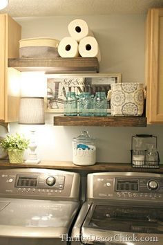 Pretty laundry room storage with DIY rustic wood shelves.