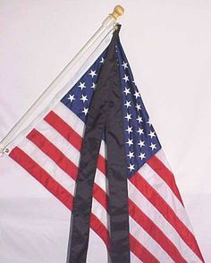 The US Flag Code, How to show mourning on a fixed flag.