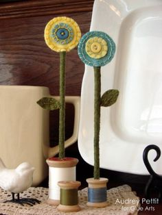"Wool flowers in spools - called ""Spring Bouquet"" on Audreys weblog."
