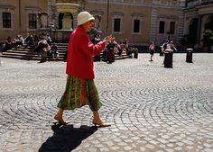"""""""Cig & Nails""""... Rome Italy I loved this woman SO. HARD. Her red coat her little shoes like slipper. And the cig. The nails. Love.   #postcardsfromrome #postsfromrome #roma #rome #fujifilmx_us Fujifilm X Series US  X-Pro 2 XF 16-55mm f/2.8"""