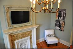 brooklyn_limestone has perhaps the most elegant solution for a TV above the fireplace – the TV screen is treated as art, and is framed accordingly. The frame is painted out to match the walls, which allows it to recede somewhat, focusing the eye on the carving and on the TV. - See more at: http://www.thingsthatinspire.net/2010/01/tv-dilemma.html#sthash.WZv3ld83.dpuf