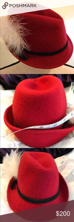 """Red Hat """"Handmade in Austria"""" Authentic Austrian handmade red stiffened felt hat. EUC!! Bought in Austria in early 80s. Has hunter green band and 2 feathers 6""""long for longest. Front brim fold is about 1 1/2""""tall and back 2"""". Fits perfectly on my 19"""" head. Please check out all photos and description before making an offer. Reasonable offers accepted but please  Lowball offers  Trades  Sales outside of Posh. Thanks for visiting my closet. ❤️ Roni Accessories Hats"""