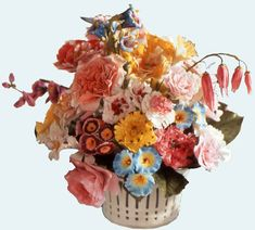 "A very rare Sèvres porcelain basket filled with some of Ivan's re-creations of eighteenth century pastillage flowers. One of the most time-consuming tasks of the eighteenth century confectioner was the creation of artificial flowers of this kind. Although these costly decorations were frequently made from silk or paper, sugar paste flowers like those above were also popular. We are told they were used to ""garnish the tops of pyramids of dried fruits - or to be arranged in a basket""."