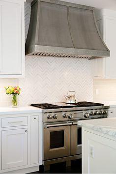 White + stainless steel kitchen.