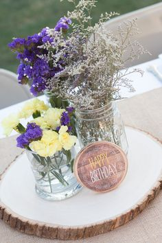 Tangled Inspired 21st Birthday: Rustic Lavender and Yellow. Simple rustic flower centerpiece with wood cut sign.